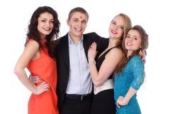Jeune homme avec trois filles et baiser-marques de rouge à lèvres Photo libre de droits