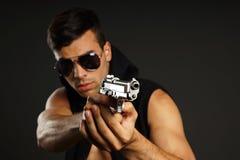 Jeune homme avec un canon Photographie stock libre de droits