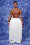 Jeune homme avec un panneau de boogie Photos stock