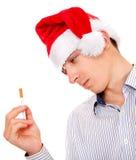 Jeune homme avec une cigarette photographie stock