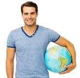 Jeune homme beau avec le globe images stock