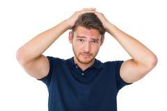 Jeune homme beau semblant confus Photographie stock libre de droits
