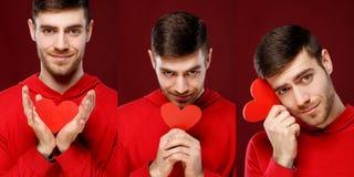 Jeune homme bel avec un coeur rouge dans des ses mains le Saint Valentin Images stock
