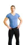 Jeune homme bel, construction musculaire, restant sur le blanc Image libre de droits