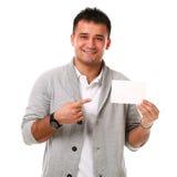 Jeune homme bel retenant le panneau blanc Image libre de droits