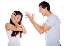 Jeune homme criant à son amie Image libre de droits