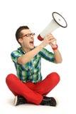 Jeune homme criant par le mégaphone Photographie stock libre de droits