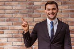 Jeune homme d'affaires attirant Images stock