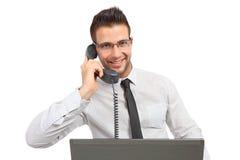 Jeune homme d'affaires au téléphone Photo stock