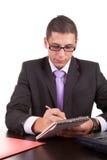 Jeune homme d'affaires au travail Photo stock