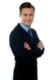 Jeune homme d'affaires avec du charme posant dans le type Photographie stock libre de droits