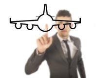 Jeune homme d'affaires avec l'avion d'isolement Image stock