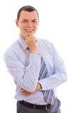 Jeune homme d'affaires avec la main près du menton Photographie stock