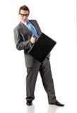 Jeune homme d'affaires avec la serviette à disposition image stock
