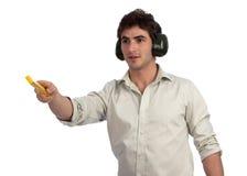 Jeune homme d'affaires avec le bâton de mesure sur le site Images stock