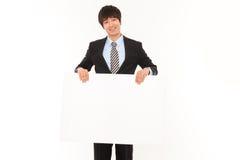 Jeune homme d'affaires avec le panneau. Photo stock