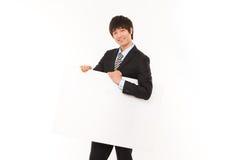 Jeune homme d'affaires avec le panneau. Photographie stock libre de droits