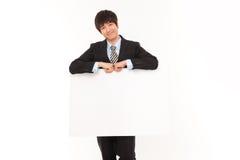 Jeune homme d'affaires avec le panneau. Photographie stock