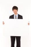 Jeune homme d'affaires avec le panneau. Images stock