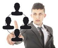 Jeune homme d'affaires avec les amis virtuels noirs d'isolement Image libre de droits