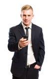 Jeune homme d'affaires beau sur le téléphone portable. photographie stock