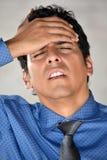 Jeune homme d'affaires colombien With Headache photographie stock libre de droits