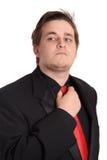 Jeune homme d'affaires débloquant la relation étroite Image stock
