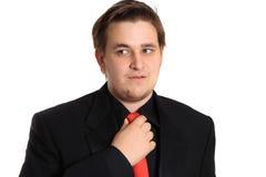 Jeune homme d'affaires débloquant la relation étroite Photo stock
