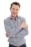 Jeune homme d'affaires de sourire dans une chemise bleue et d'isolement sur un petit morceau photo stock
