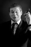 Jeune homme d'affaires drôle avec le cigare Images stock
