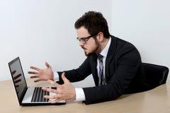 Jeune homme d'affaires fâché Photos stock