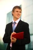 Jeune homme d'affaires heureux Photographie stock