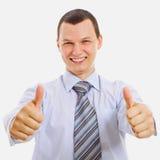 Jeune homme d'affaires heureux affichant le pouce vers le haut Photos stock