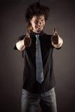Jeune homme d'affaires montrant le doigt  Photos stock