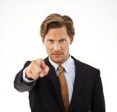 Jeune homme d'affaires Pointing à l'appareil-photo Photographie stock libre de droits
