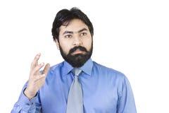 Jeune homme d'affaires posant la question Photos libres de droits
