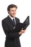 Jeune homme d'affaires posant tenant un dossier photos libres de droits