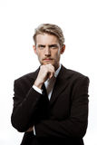 Jeune homme d'affaires réussi pensant avec la main sur le menton au-dessus du fond blanc Photo libre de droits