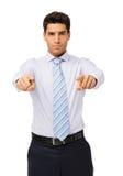 Jeune homme d'affaires sérieux Pointing At You Image stock