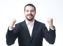 Jeune homme d'affaires victorieux Photo stock