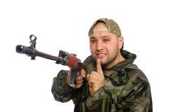 Jeune homme dans l'arme à feu se tenante uniforme de soldat d'isolement Photographie stock libre de droits