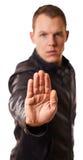 Jeune homme dans la main d'arrêt d'expositions de veste en cuir concept de démenti, refusé - d'isolement Images stock