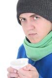 jeune homme dans le chandail bleu et l'écharpe verte avec du Cu Photo stock