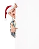 Jeune homme dans le chapeau de Santa photo stock