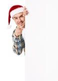Jeune homme dans le chapeau de Santa Photo libre de droits