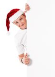 Jeune homme dans le chapeau de Santa Photographie stock libre de droits