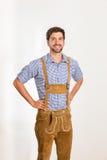 Jeune homme dans le pantalon en cuir Photographie stock libre de droits