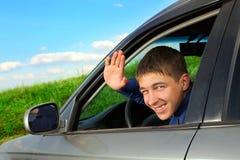 Jeune homme dans le véhicule Photo libre de droits