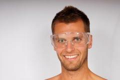 Jeune homme dans les lunettes images stock