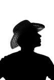 Jeune homme dans un chapeau de paille - silhouette Photographie stock libre de droits